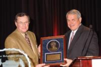 Amarillo High School's Larry Dippel received the Power of Influence Award from AFCF President Ken Hatfield