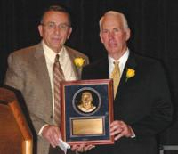 AFCF president R.C. Slocum presented the 2006 Power of Influence Award to Sid Otton